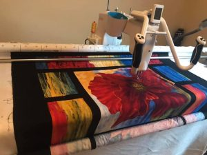 my longarm machine, a q'nique15 pro on a continuum frame, from Grace company.