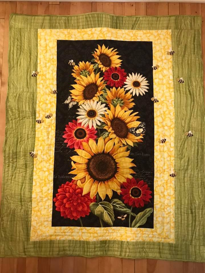 Jody's quilt, with bees around a panel - one of many sunflower panels I had